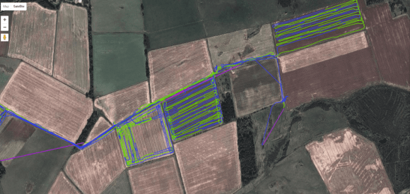 A series of lines traces crop rows on a satellite picture of a field in England.