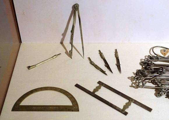 A display of surveyor's tools at the Concord Museum.