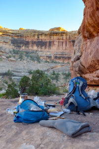 A photograph of camping gear outside in a desert canyon.
