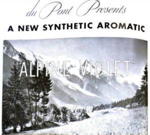 """A print ad that reads """"Du Point presents a new synthetic aromatics 'Alpine Violet'"""" against the image of a an alpine meadow with snow-capped mountains in the background."""