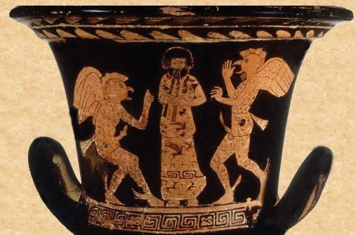 Close up of a black vase. In bronze paint, two winged men surround a robed man playing a pipe.