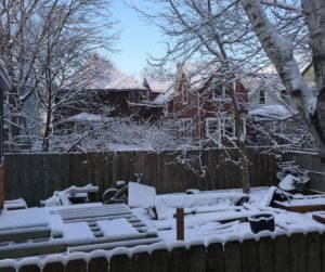 A backyard is covered in a fresh layer of snow in April, 2018.