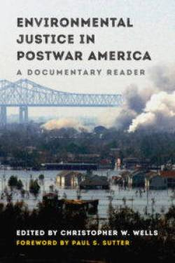 """The cover of """"Environmental Justice in Postwar America: A Documentary Reader"""" edited by Christopher W. Wells. The photograph shows a large bridge above a flooded residential neighborhood with smoke spewing from factories in the middle distance."""