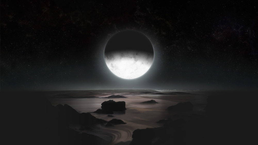 A white moon half in shadow sits in a black sky casting light on a shadowy landscape of rocky outcroppings and a foggy floodplain.