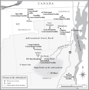 A grayscale map of Northern New York showing the locations of eleven correctional facilities inside and bordering Adirondack State Park, evidence of a building boom in the history of mass incarceration.