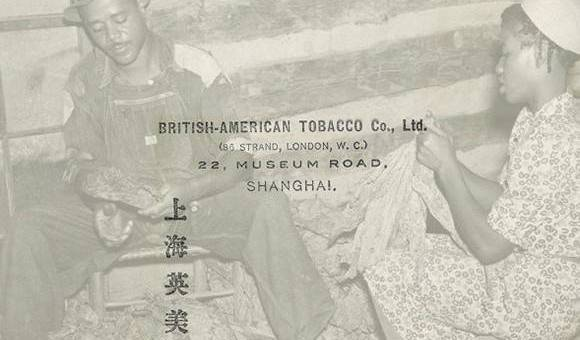 A woman and man tie leaves of tobacco together with a return address for the British-American Tobacco Company in Shanghai and Chinese characters superimposed over them.