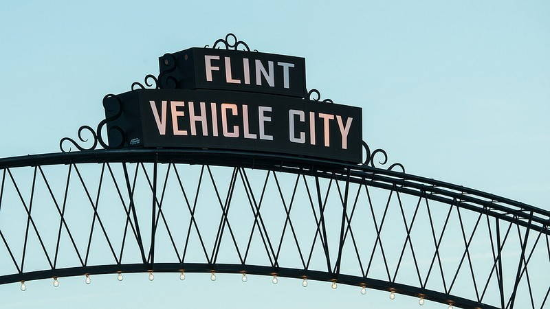 Metal arch in downtown Flint, Michigan. Flint, Vehicle City