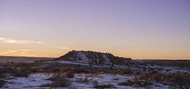 A snowy desert plateau at sunrise