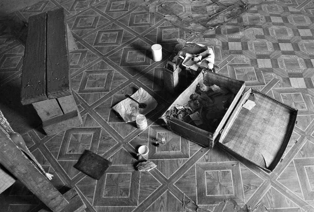 A traditional healer's things are laid out on the floor of her home.
