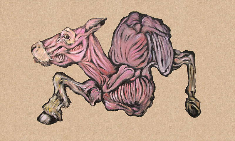 A skinned cow with contorted limbs and exposed pink muscles.