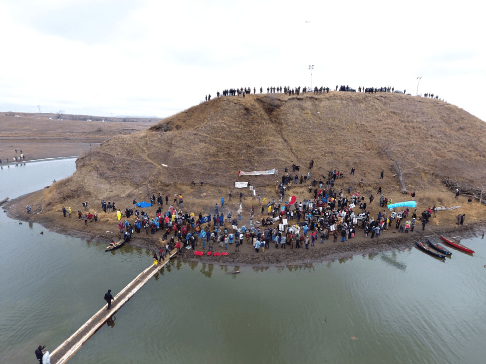 Police and protestors stand off at Turtle Island