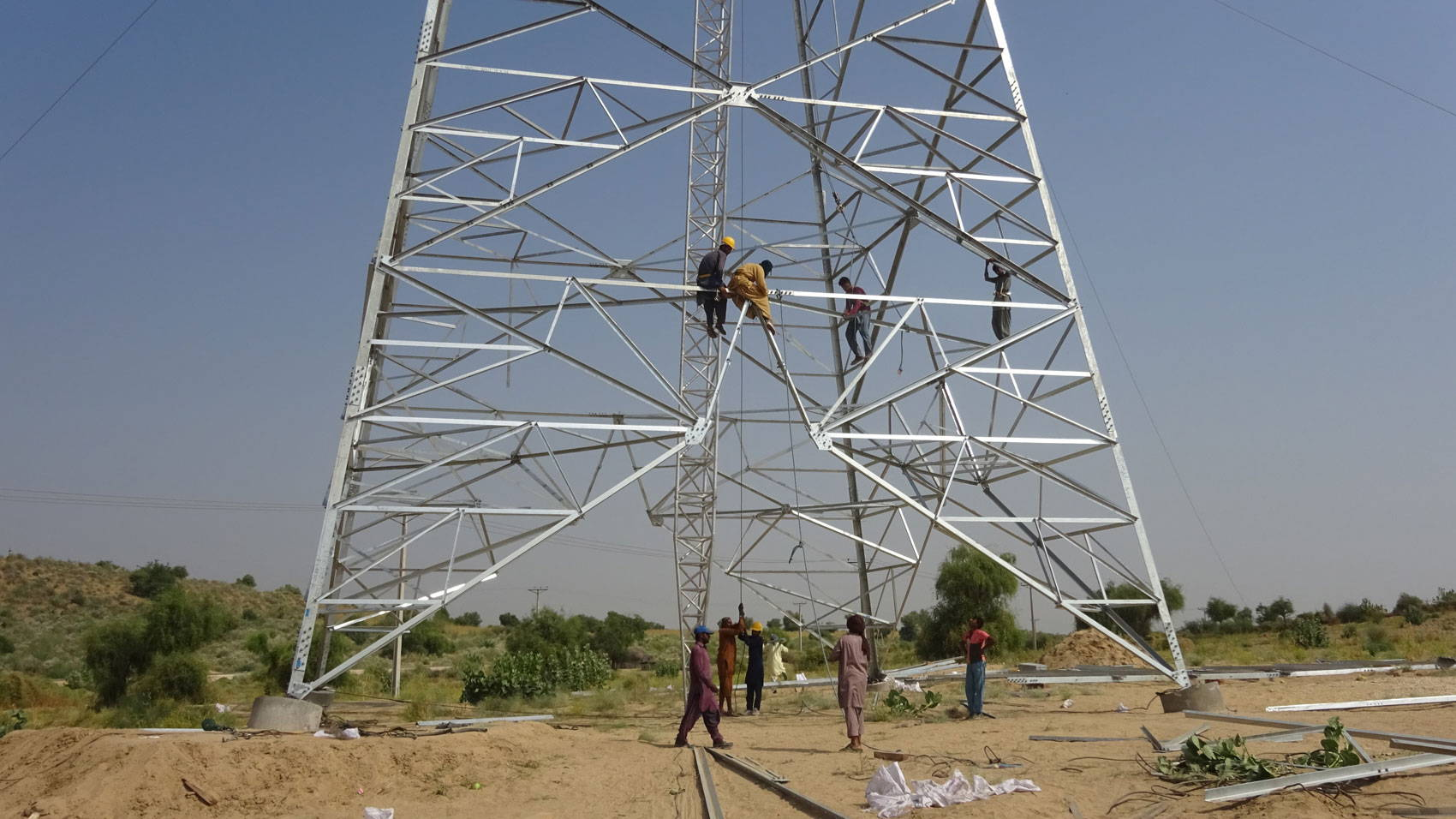 People climb on a large metal structure