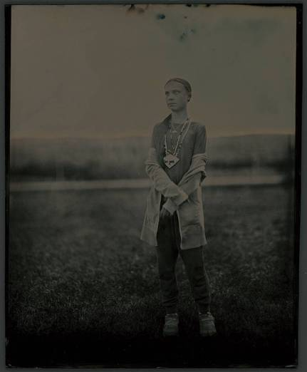 A tintype photograph shows a full-length portrait of climate change activist and environmental icon Greta Thunberg at the Standing Rock Sioux Reservation.