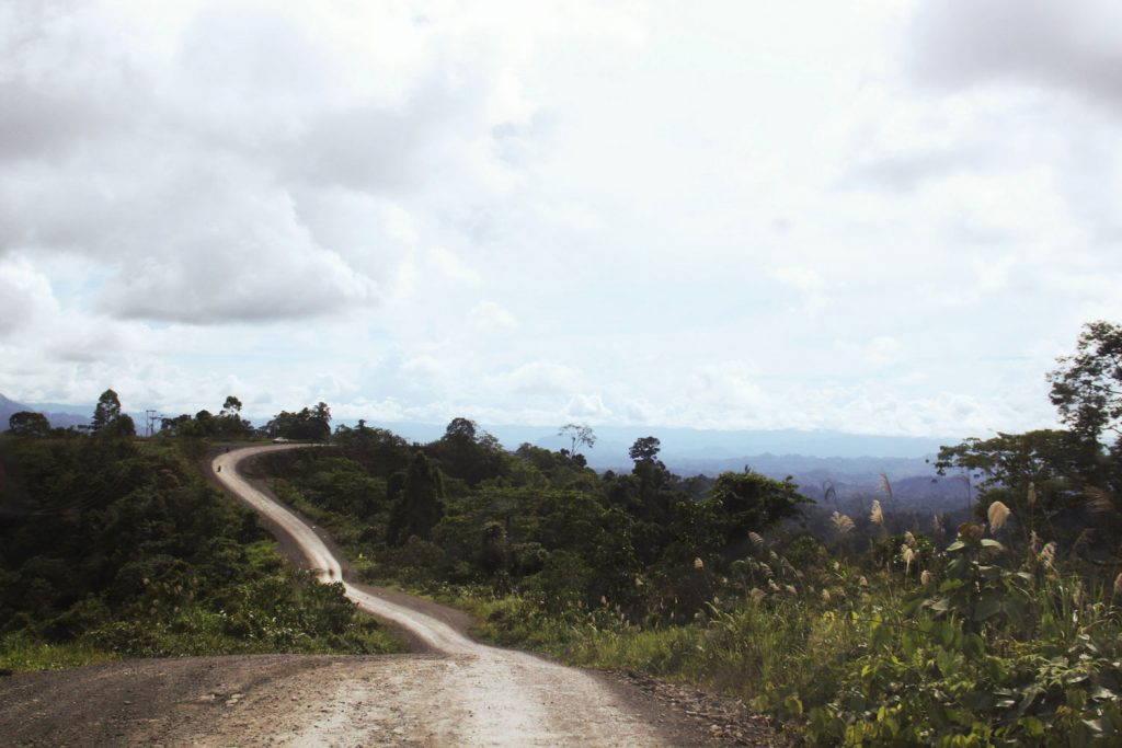Long dirt road winds along a hilltop