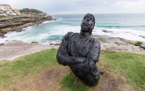 A statue of a person made of coal