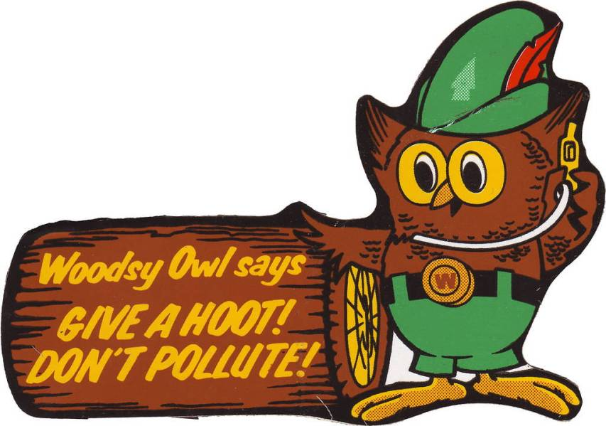 """Cartoon owl stands next to log that reads """"Woodsy Owl says: Give a Hoot! Don't Pollute!"""""""