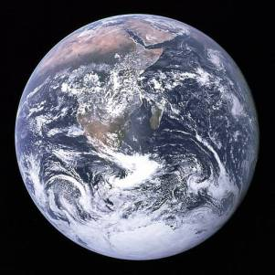 Image of planet Earth from space; a ball of blue and white swirls