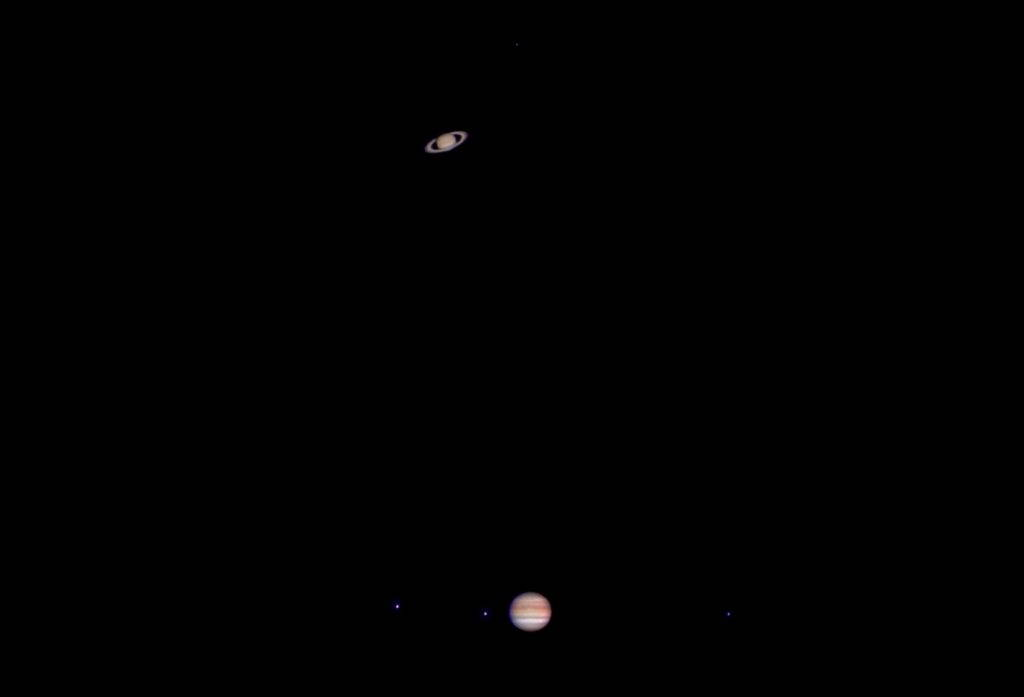 black sky with Saturn in the background and Jupiter in the foreground