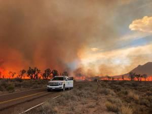Smoke-filled sky over burning Cima Dome landscape