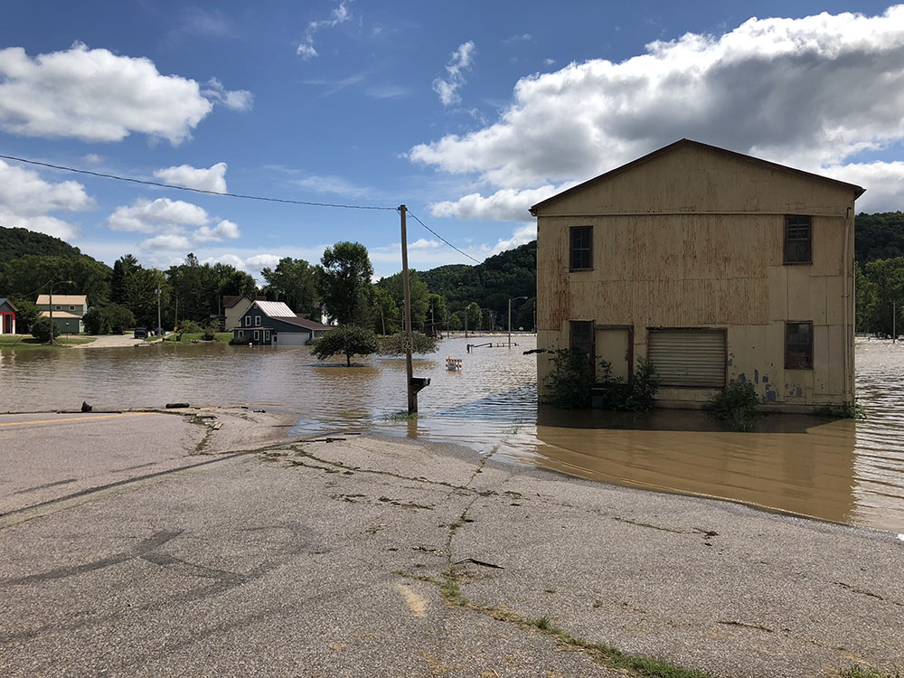 Flood water on concrete near an old building