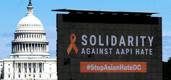 """A sign saying """"Solidarity Against AAPI Hate"""" in front of the National Mall"""
