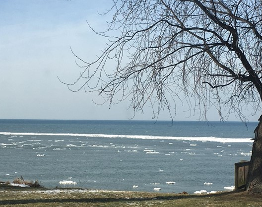 Patches of ice on blue waters of Lake Erie.