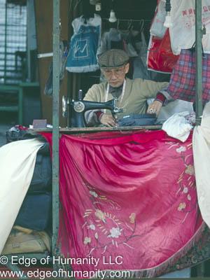 Man Sewing In Hong Kong.
