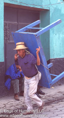 Man carrying a table using his head in Venezuela.