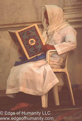 Man reading inside of the Umayyad Mosque, Damascus, Syria.
