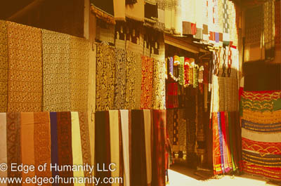 Textiles displayed outside of a small shop, Damascus, Syria.