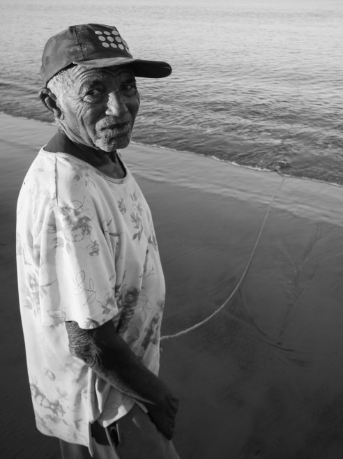 A fisherman hangs his line, Saint Augustin, Madagascar