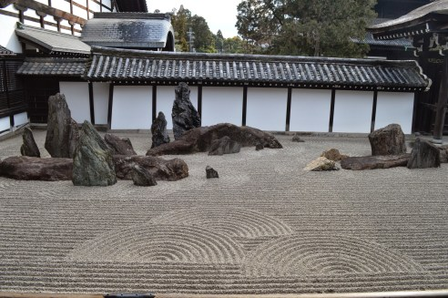 Hojyo Garden, Tofuku-ji Temple. The rocks symbolize the Elysian islands and the swirling raked-gravels symbolize the eight rough seas.