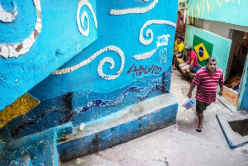 Coming back from grocery store - Vila Canoas Slum (Favela), Rio de Janeiro, Brazil.