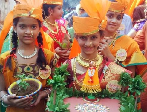 Children spreading message of saving the planet - Gudi Padva Carnival, India.