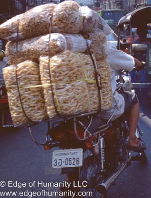Man transporting goods on motorcycle - Vietnam.
