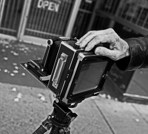 Proud old school photographer Hamilton On, another street photographer out and about he would not let me take his picture usually I don't ask but after talking with him for about 45 minutes their was mutual respect so I settled for his hand and camera.
