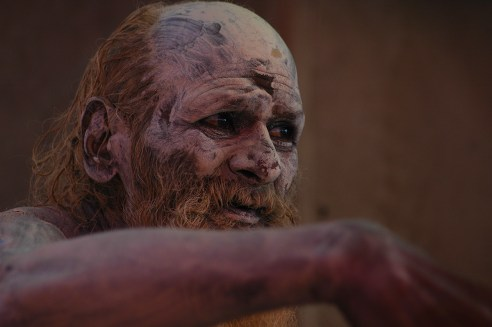 This ash smeared sadhu was sitting in his camp during Kumbh Mela at Allahabad. I saw him getting furious when people tried to take a picture without giving alms.
