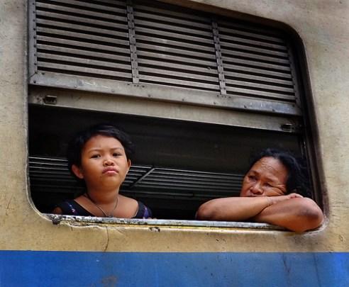 Boredom - A long hot train journey awaits and the boredom has set in already! Bangkok, Thailand