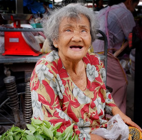 Market seller - This elderly lady was happily selling her greens at a local market. Hua Hin, Central Thailand.