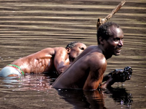 "Borana men collect salt with bare hands in a salt lake. The salt is called ""black gold"". Ethiopia."