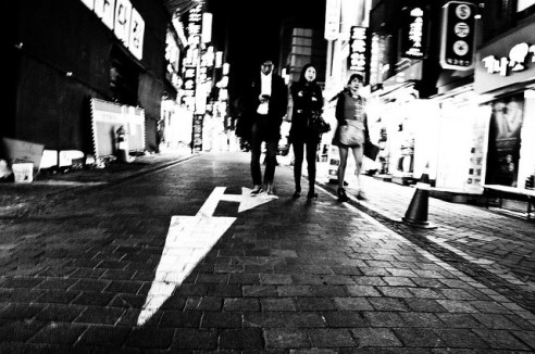 Obedience: The arrow points the way for these pedestrians in Seoul. South Korea