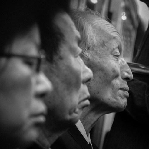With age comes… : Three commuters on a Daegu subway train. South Korea