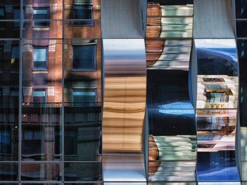 Distorted reflection on the facade of One57 on West 57th Street, New York City, USA