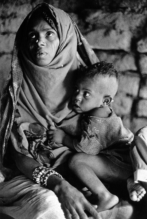Eritrean mother and child, at a feeding clinic. Khashm el Girba refugee camp, Sudan, 1987.