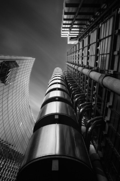 Jack and the Metal Beanstalk Two iconic buildings standing tall in the City of London. The Willis building and The Lloyds building (also known as the inside out building) stand reaching for the sky.