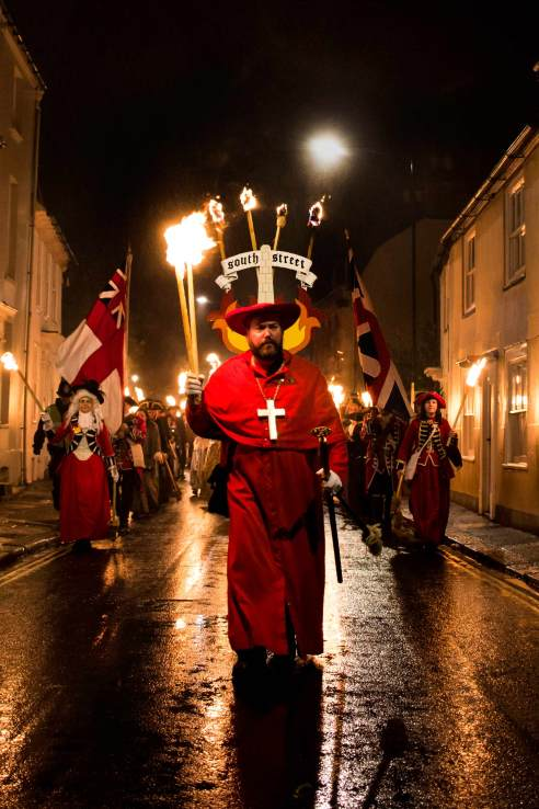 The South Street Bonfire Society, led by one of the Archbishops sets off on their procession route.