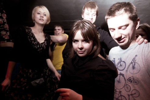 A group of young people dancing in the club called Zoccolo.