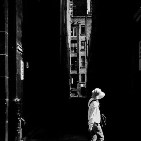White hat, black alley Little Bourke Street, Melbourne, Australia.