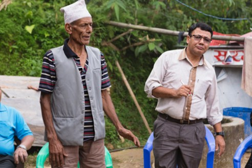 Community farmer Dilli Ram Regmi with iDE Nepal representative, introduces himself to the group in Sirubari, rural Nepal.