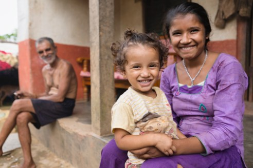 Farmer Dipa Regmi and daughter sit proud by their home in the Sirubari village of rural Nepal.